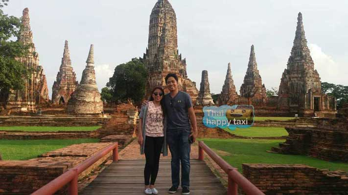 Our lovely couple guests take the trip with our Bangkok taxi and tours service to the beautiful temple ruins at Ayutthaya Historical Park.
