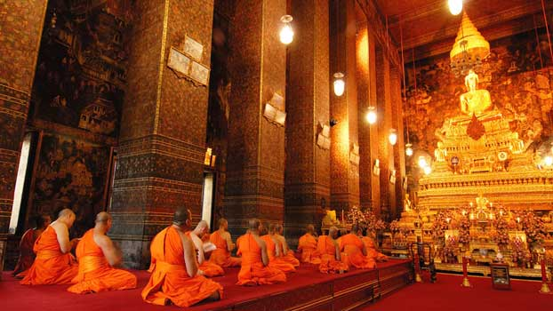 A common sight in Bangkok of monks chanting