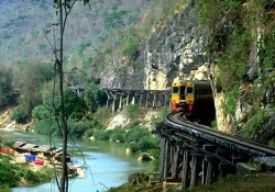 The historic WWII bride on the river Kwai and the railway is a scenic route in Kanchanaburi today
